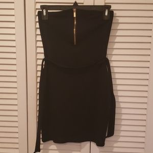 Black strapless dress with gold zip up front